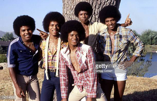 Tito Jackson, Marlon Jackson, Michael Jackson, Randy Jackson and Jackie Jackson of The Jacksons pose during a publicity photo shoot after the band...