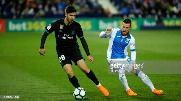 Tito of Leganes and Marco Asensio of Real Madrid battle for the ball during the La Liga match between CD Leganes and Real Madrid at Estadio Municipal...
