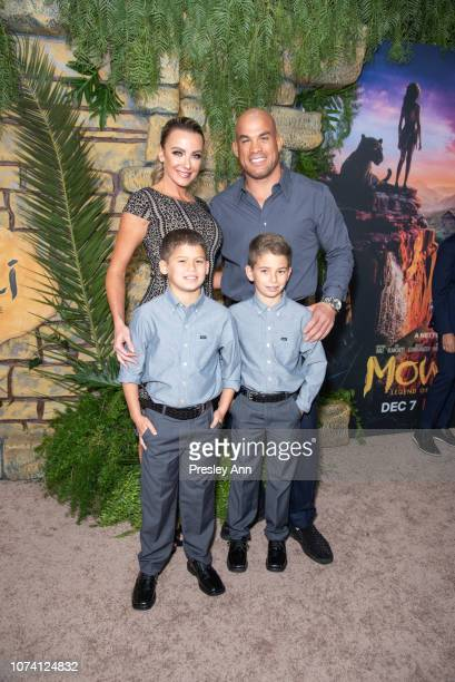 Tito Ortiz and Amber Nichole Miller attend Premiere Of Netflix's 'Mowgli' at ArcLight Hollywood on November 28 2018 in Hollywood California