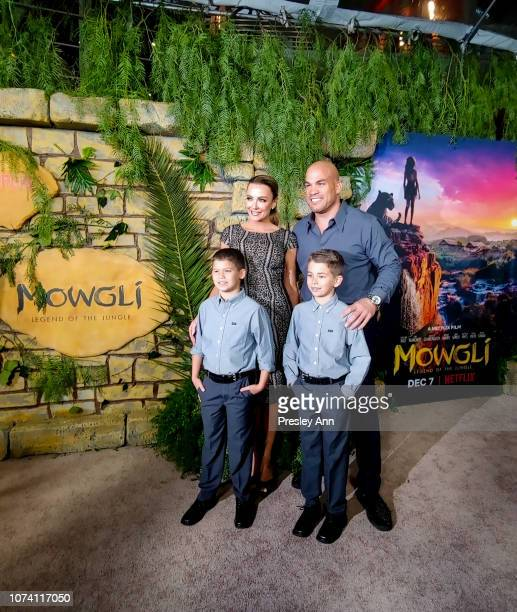 Tito Ortiz and Amber Nichole Miller attend the premiere of Netflix's 'Mowgli' at ArcLight Hollywood on November 28 2018 in Hollywood California