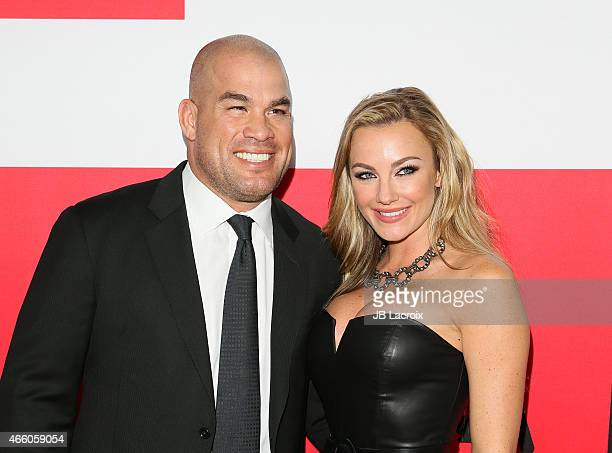 Tito Ortiz and Amber Nichole Miller attend the premiere of Open Road Films' 'The Gunman' at Regal Cinemas LA Live on March 12 2015 in Los Angeles...