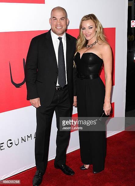 Tito Ortiz and Amber Nichole Miller attend the premiere of The Gunman at Regal Cinemas LA Live on March 12 2015 in Los Angeles California