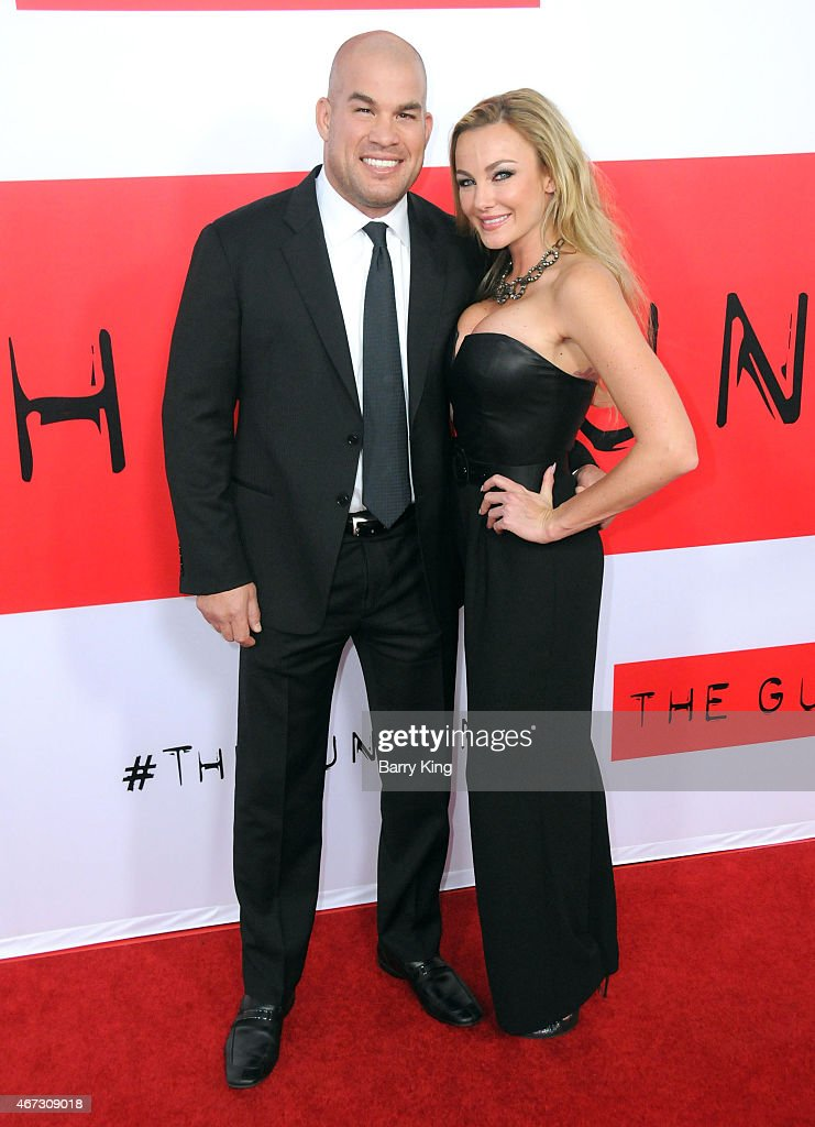 Tito Ortiz and Amber Nichole Miller attend the premiere of 'The Gunman' at Regal Cinemas L.A. Live on March 12, 2015 in Los Angeles, California.