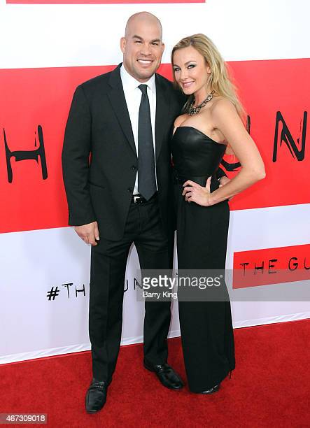 Tito Ortiz and Amber Nichole Miller attend the premiere of 'The Gunman' at Regal Cinemas LA Live on March 12 2015 in Los Angeles California