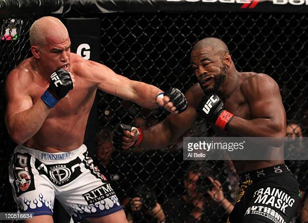 Tito Ortiz punches Rashad Evans during a light heavyweight bout at UFC 133 at Wells Fargo Center on August 6 2011 in Philadelphia Pennsylvania