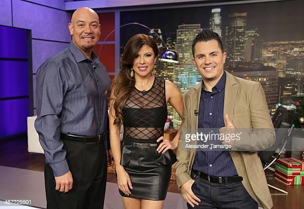 Titulares y Mas hosts Edgar Lopez, Mirella Grisales and Karim Mendiburu pose at Telemundo Studio on December 16, 2013 in Miami, Florida.