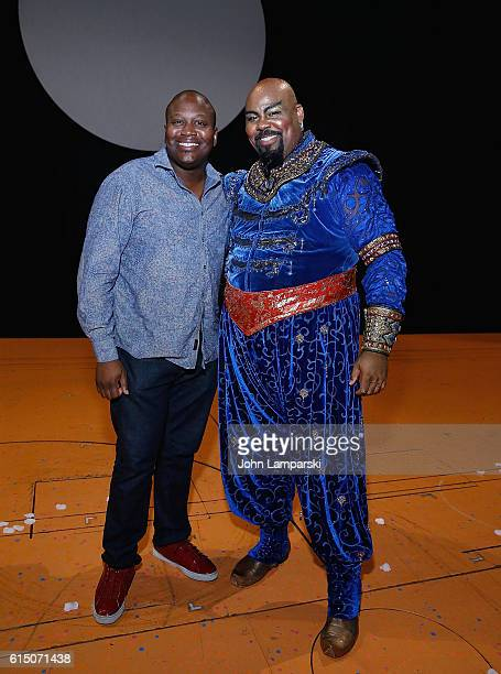 Titus Burgess and James Monroe Iglehart pose during Aladdin on Broadway at New Amsterdam Theatre on October 16 2016 in New York City
