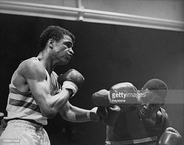 Titus Simba of Tanzania fights John Conteh of England in the Middleweight final of the Boxing during the British Commonwealth Games in Edinburgh,...