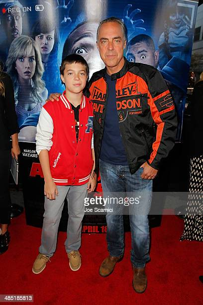 Titus Welliver and Quinn walk the A Haunted House 2 Los Angeles Premiere Red Carpet at Regal Cinemas LA Live on April 16 2014 in Los Angeles...