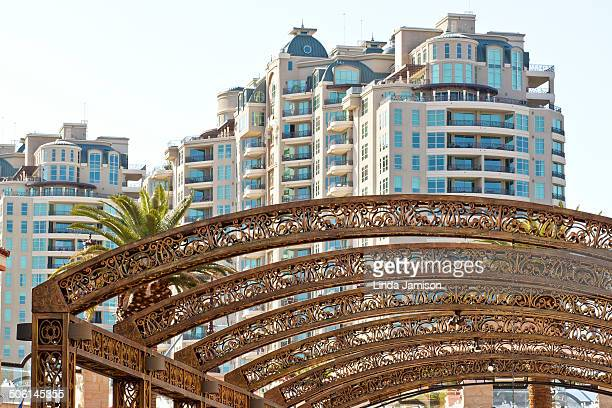 Tivoli Square in Las Vegas, Nevada. View of arched arbor and the SunCoast hotel and casino. Palm trees also within photo.