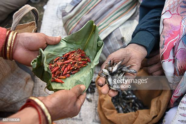 Tiwa tribal people exchange goods with others using an ancient bartering system at the Jonbeel Mela festival in the Morigaon district of Assam some...