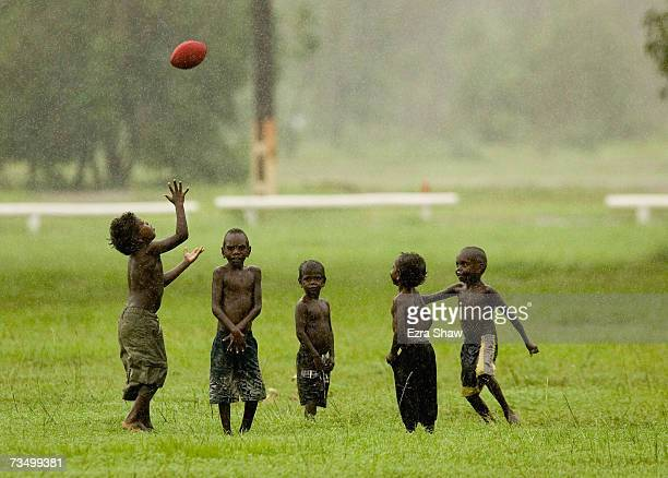 Tiwi Island residents play Australian Rules football at their local oval March 5, 2007 on the Tiwi Island, Australia. Australian Rules football holds...