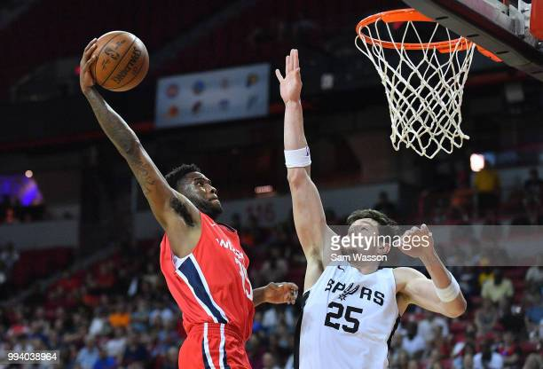 Tiwian Kendley of the Washington Wizards dunks against Drew Eubanks of the San Antonio Spurs during the 2018 NBA Summer League at the Thomas Mack...