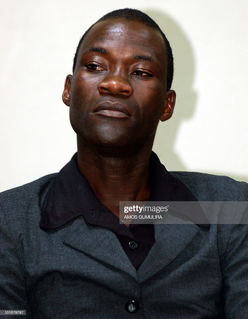 Tiwonge Chimbalanga is seen prior to a press conference in Liongwe on June 2, 2010, five days after Malawi's President Bingu wa Mutharika pardoned Tiwonge Chimbalanga, 20, and Steven Monjeza, 26. The Malawian gay couple who received a presidential pardon on a 14-year sentence for sodomy called President Bingu wa Mutharika a 'caring father' and a 'tolerant president'. The pardon followed a meeting between Mutharika and United Nations chief Ban Ki-moon. Malawi has been sharply criticised by the international community for jailing the couple and maintaining laws that criminalise homosexuality.