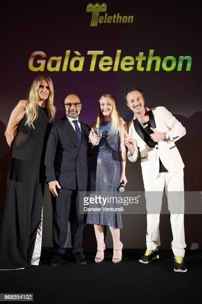 Tizian Rocca Hormoz Vasfi Dakota Fanning and Francesco Facchinetti attend Telethon Gala during the 12th Rome Film Fest at Villa Miani on October 30...