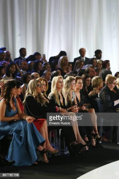 Tiziana Rocca, Adriana Volpe and Gloria Guida attend the runway of the Nicole fashion show at Palazzo Dei Congressi on March 25, 2017 in Rome, Italy.