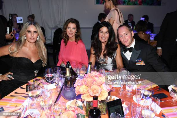 Tiziana Rocca Alessandra Repini Cristina Ferrari and a guest attend amfAR Gala dinner at La Permanente on September 22 2018 in Milan Italy