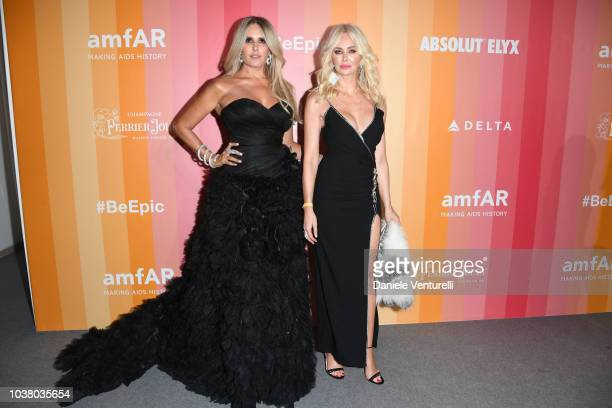 Tiziana Rocca and Amanda Caroline Cronin walk the red carpet ahead of amfAR Gala at La Permanente on September 22 2018 in Milan Italy