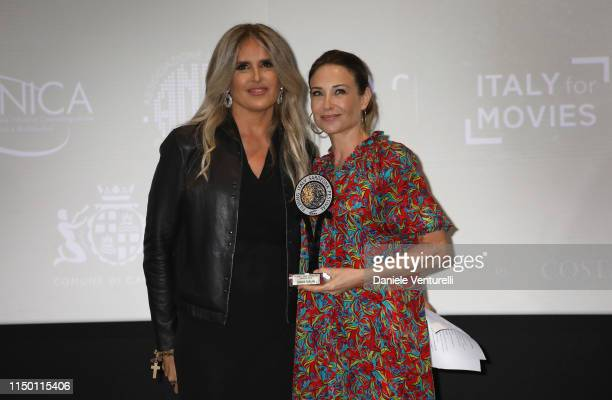 Tiziana Rocca and Claire Forlani attend the Filming Italy Sardegna Festival 2019 Day 2 at Forte Village Resort on June 14 2019 in Cagliari Italy