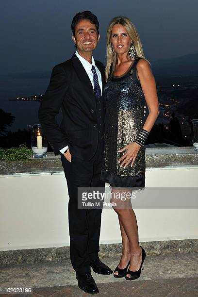 Tiziana Rocca and Giulio Base attend a party at Lancia Cafe during the Taormina Film Fest on June 12 2010 in Taormina Italy