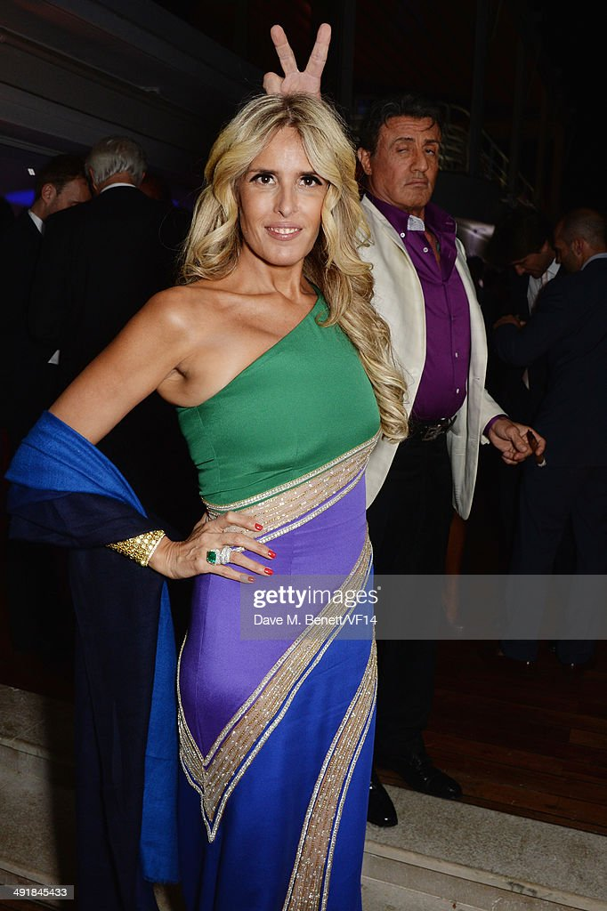 Tiziana Rocca and Sylvester Stallone attend the Vanity Fair And Armani Party at the 67th Annual Cannes Film Festival on May 17, 2014 in Cap d'Antibes, France.