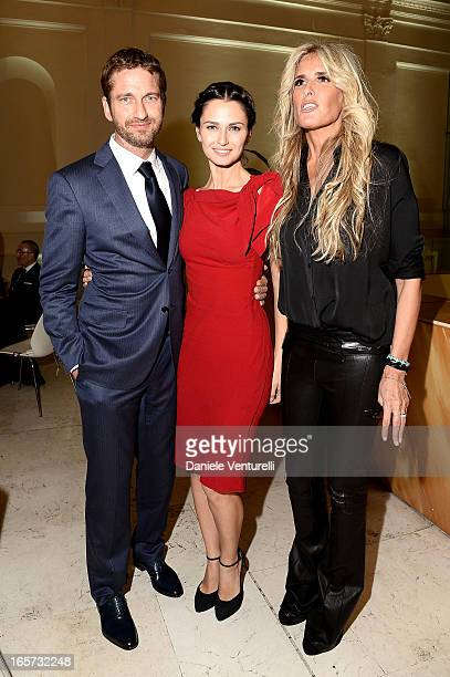Tiziana Rocca Anna Safroncik and Aaron Eckhart attend a gala dinner by Antonello Colonna for the movie 'Olympus Has Fallen' on April 5 2013 in Rome...