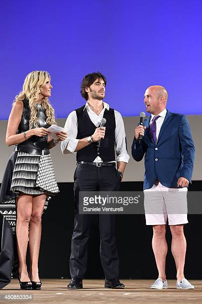 Tiziana Rocca Giulio Berruti and James Richardson attend the 60th Taormina Film Fest on June 18 2014 in Taormina Italy