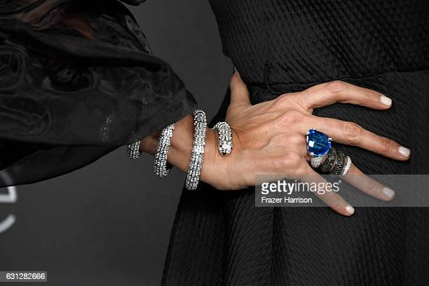 Tiziana Rocca jewelry detail attends the 18th Annual PostGolden Globes Party hosted by Warner Bros Pictures and InStyle at The Beverly Hilton Hotel...