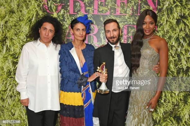 Tiziano Guardini , winner of the The Franca Sozzani GCC Award for Best Emerging Designer, poses backstage with presenters Sara Sozzani Maino, Helen...