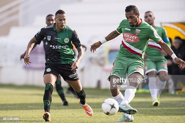 Tjaronn Chery of FC Groningen in duel with a player of Mouloudia Club d'Alger During the friendly match between FC Groningen and Mouloudia Club...