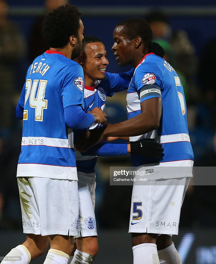 Tjarron Chery of Queens Park Rangers celebrates after he scores to make it 1-0 with James Perch and Nedum Onuoha of Queens Park Rangers during the Sky Bet Championship match between Queens Park Rangers and Derby County at at Loftus Road on March 8, 2016 in London, England.