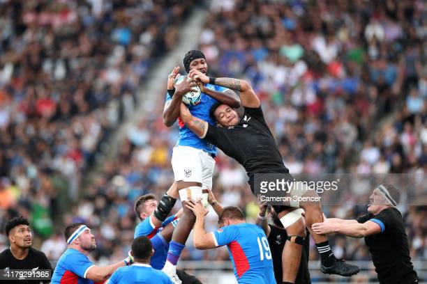 Tjiuee Uanivi of Namibia and Shannon Frizell of New Zealand compete at a line out during the Rugby World Cup 2019 Group B game between New Zealand...
