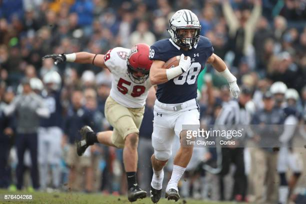 tJP Shohfi of Yale makes a break while challenged by Joey Goodman of Harvard during the Yale V Harvard Ivy League Football match at the Yale Bowl...