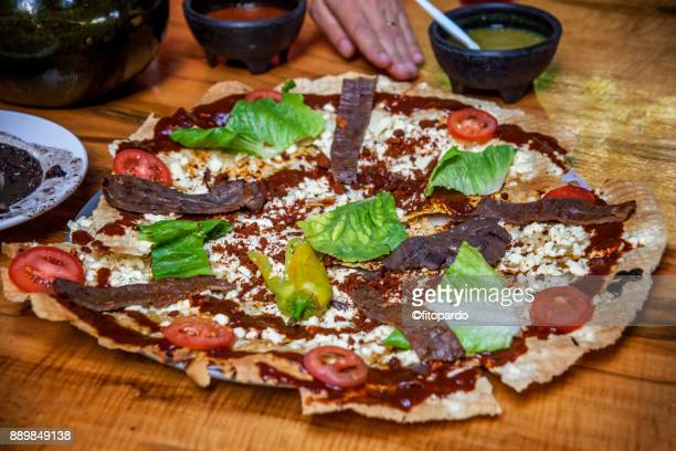 tlayuda flat bread quesadilla from oaxaca - mole sauce stock pictures, royalty-free photos & images
