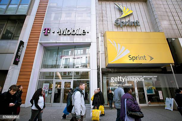 TMobile and Sprint Nextel cellular phone stores adjoin each other in Herald Square in New York on Tuesday March 8 2011 Sprint announced ti is cutting...