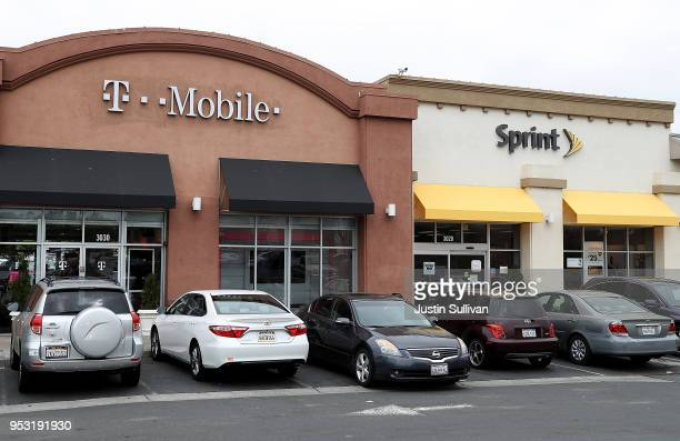 Mobile and Sprint store sit sidebyside in a strip mall on April 30 2018 in El Cerrito California TMobile announced plans to acquire Sprint for $26...