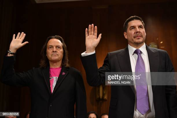 TMobile CEO John Legere and Sprint Executive Chairman Marcelo Claure are sworn in before the Senate Judiciary Committee's Subcommittee on Antitrust...