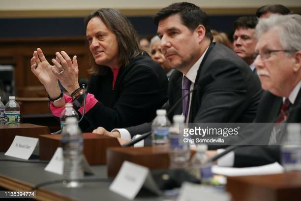 TMobile CEO John Legere Sprint Executive Chairman Marcelo Claure and Communications Workers of America President Chris Shelton testify before the...