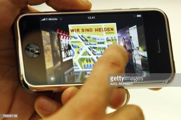 A TMobile employee holds a iPhone during a press conference in Berlin 19 September 2007 TMobile will be the exclusive provider of the iPhone for...
