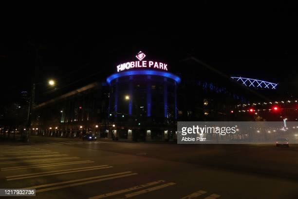 Mobile Park is lit up in blue to honor essential workers during the coronavirus outbreak on April 09, 2020 in Seattle, Washington. Landmarks and...