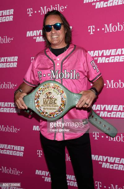 Mobile US CEO John Legere poses with the WBC Money Belt on TMobile's magenta carpet duirng the Showtime WME IME and Mayweather Promotions VIP...