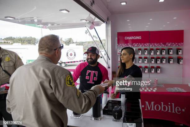 TMobile US Inc employees distribute free cell phone chargers at an emergency response center on Zuma Beach during the Woolsey Fire in Malibu...