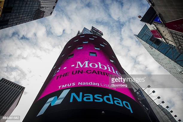 TMobile US Inc signage and ticker symbol are displayed on the exterior of the Nasdaq MarketSite in New York US on Tuesday Oct 27 2015 TMobile US Inc...
