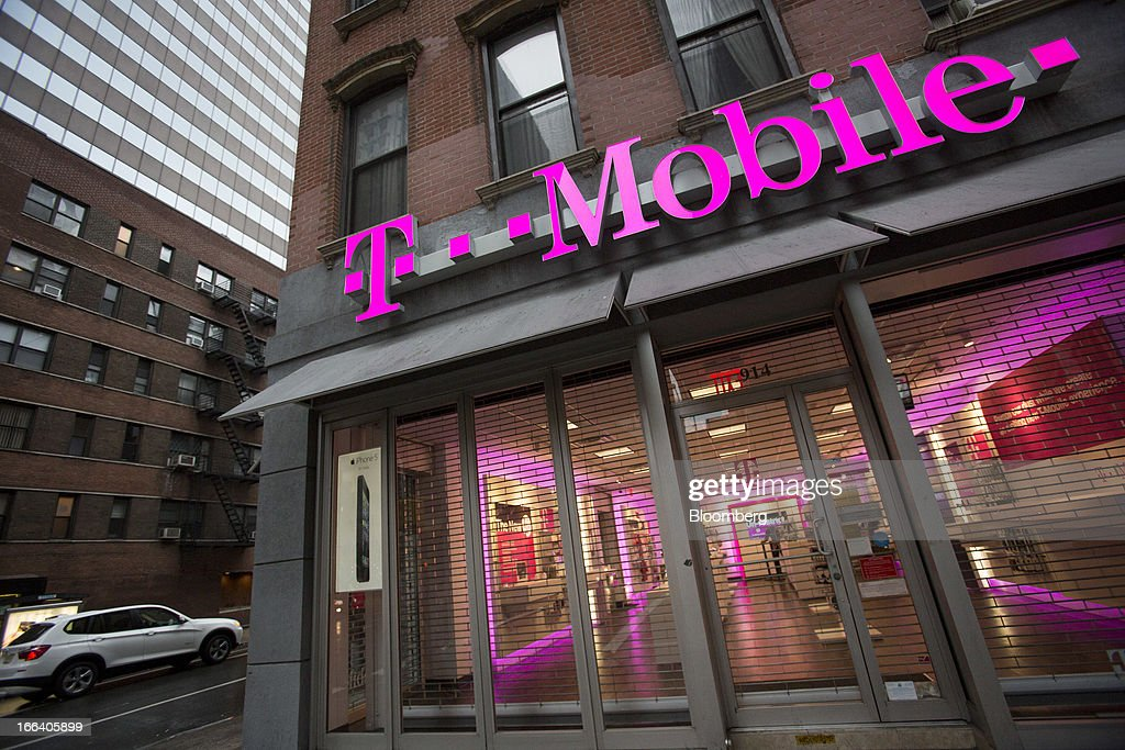 A T-Mobile USA Inc. retail location stands in New York, U.S., on Friday, April 12, 2013. T-Mobile USA Inc., the fourth-largest U.S. wireless carrier, will begin offering Apple Inc.'s iPhone for the first time today, providing the biggest showcase yet for its new installment-plan approach to selling phones. Photographer: Scott Eells/Bloomberg via Getty Images