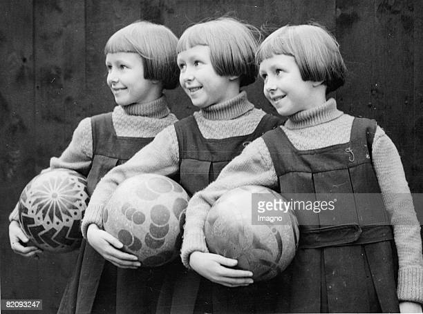 To avoid confusions of these triplets their initials were sewed on their chlothes Also their playballs have different patterns Photograph England Feb...