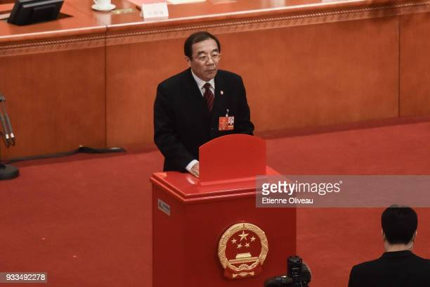 To be appointed Director of the National Supervisory Commission Yang Xiaodu votes during the sixth plenary session of the National People's Congress...