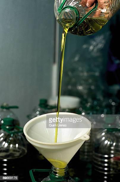 To bottle oil Jaen Oil bottled manually with strainer in Guarroman