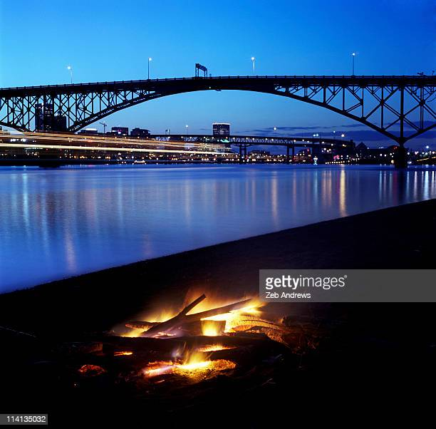to build a fire in portland, and then to watch it - willamette river stock photos and pictures