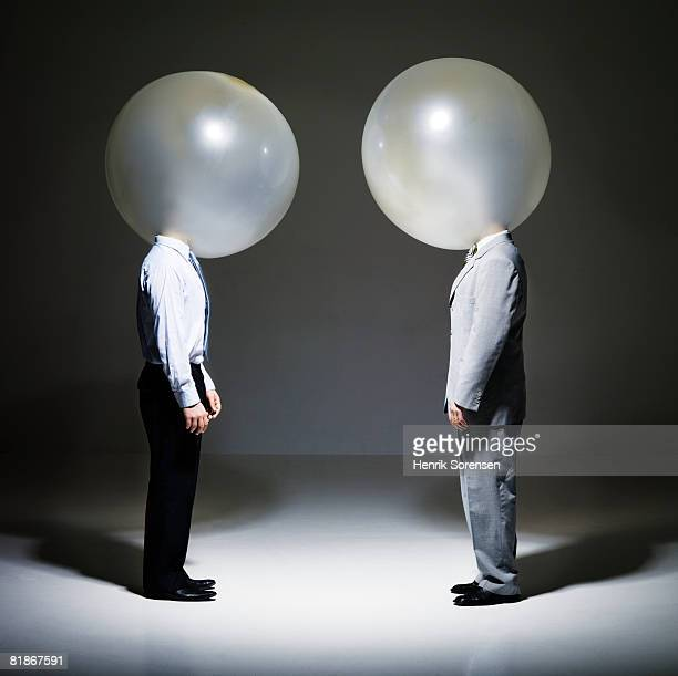 To businessmen with balloon heads
