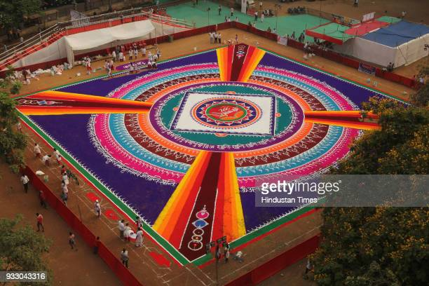 To celebrate Gudhi Padwa a new year of Hindus Rangavalli Parivar Rang Rasik Trust has decided to celebrate this festival with drawing huge 18000 sq...